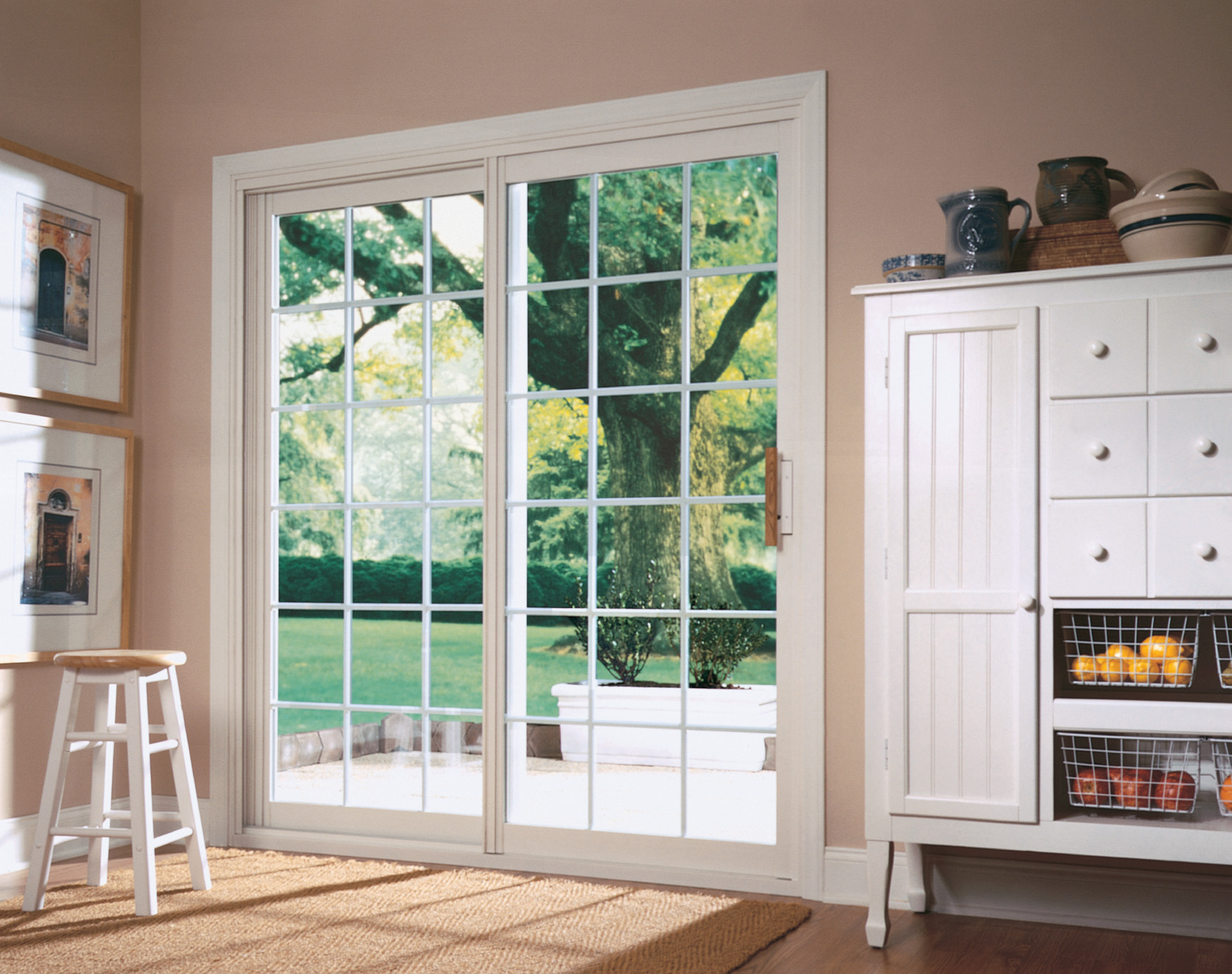 Warm light enters the room through a classic French door